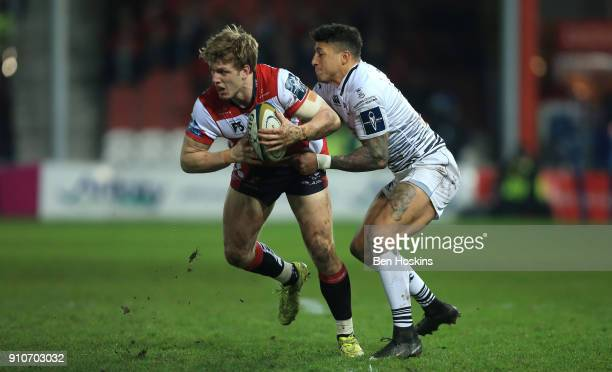 Ollie Thorley of Gloucester is tackled by Jay Baker of Ospreys during the AngloWelsh Cup match between Gloucester Rugby and Ospreys at Kingsholm...