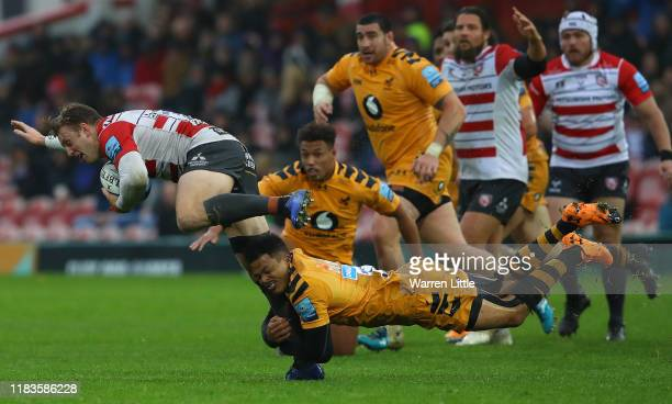 Ollie Thorley of Gloucester is tackled by Juan de Jongh of Wasps during the Gallagher Premiership Rugby match between Gloucester Rugby and Wasps at...