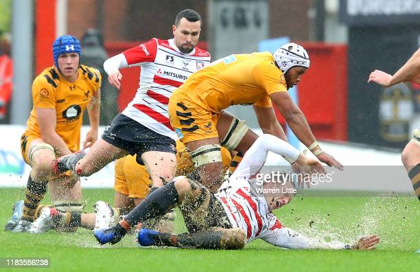 Ollie Thorley of Gloucester is tackled by Nizaam Carr of Wasps during the Gallagher Premiership Rugby match between Gloucester Rugby and Wasps at on...