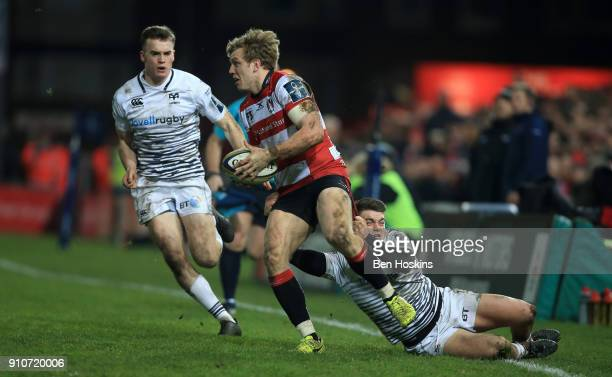 Ollie Thorley of Gloucester is tackled by Reuben MorganWilliams of Ospreys during the AngloWelsh Cup match between Gloucester Rugby and Ospreys at...