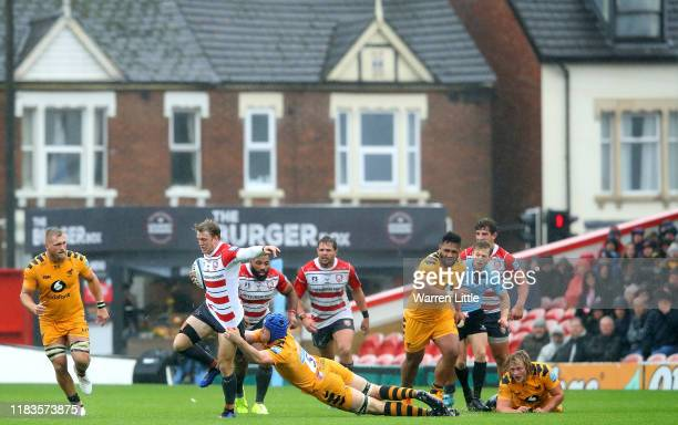 Ollie Thorley of Gloucester is tackled by Thibaud Flament of Wasps during the Gallagher Premiership Rugby match between Gloucester Rugby and Wasps at...
