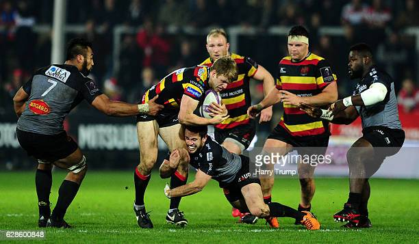 Ollie Thorley of Gloucester Rugby is tackled by Victor Vito of La Rochelle during the European Rugby Challenge Cup match between Gloucester Rugby and...