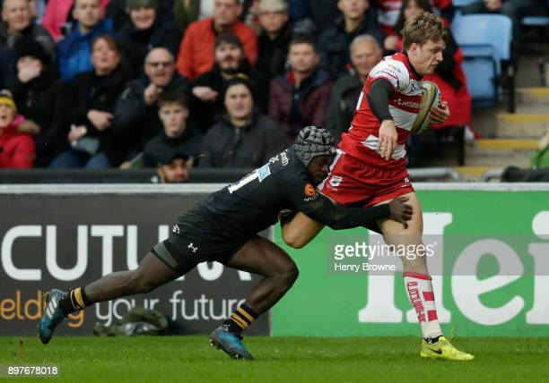 Ollie Thorley of Gloucester tackled by Christian Wade of Wasps during the Aviva Premiership match between Wasps and Gloucester Rugby at The Ricoh...