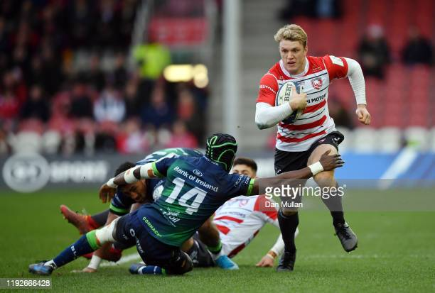 Ollie Thorley of Gloucester takes on Niyi Adeolokun of Connacht during the Heineken Champions Cup Round 3 match between Gloucester Rugby and Connacht...