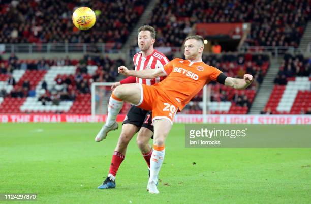 Ollie Turton of Blackpool clears the ball from Aiden McGeady of Sunderland during the Sky Bet League One match between Sunderland and Blackpool at...