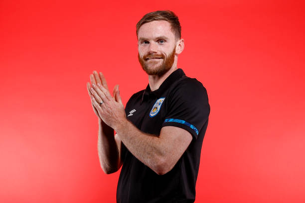 GBR: Huddersfield Town Unveil New Signing Ollie Turton