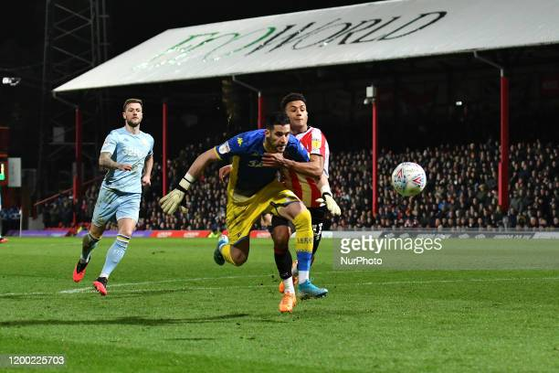 Ollie Watkins and Kiko Casilla during the Sky Bet Championship match between Brentford and Leeds United at Griffin Park London on Tuesday 11th...