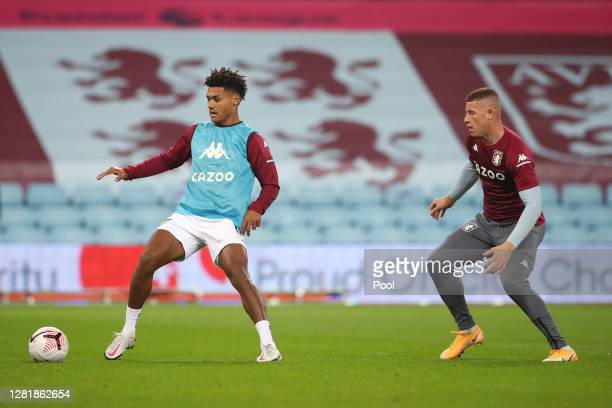 Ollie Watkins and Ross Barkley of Aston Villa warm up prior to the Premier League match between Aston Villa and Leeds United at Villa Park on October...
