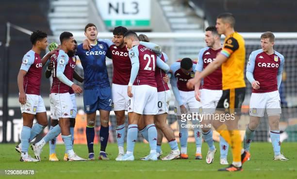 Ollie Watkins, Jacob Ramsey, Emiliano Martinez, Tyrone Mings, Jack Grealish, and Anwar El Ghazi of Aston Villa celebrate following their team's...