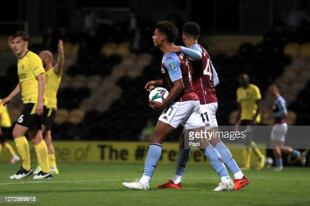 Ollie Watkins of Aston Villa celebrates after scoring his team's first goal during the Carabao Cup Second Round match between Burton Albion and Aston...