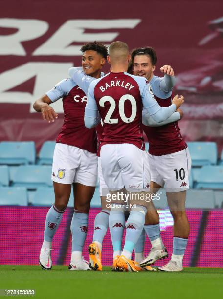 Ollie Watkins of Aston Villa celebrates after scoring his team's first goal during the Premier League match between Aston Villa and Liverpool at...