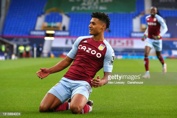 Ollie Watkins of Aston Villa celebrates after scoring the opening goal during the Premier League match between Everton and Aston Villa at Goodison...
