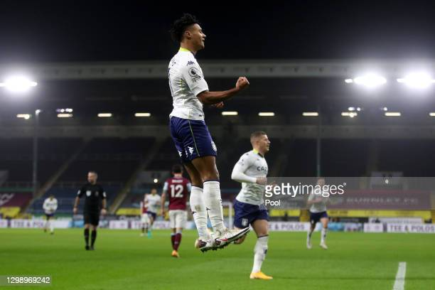Ollie Watkins of Aston Villa celebrates after scoring their sides first goal during the Premier League match between Burnley and Aston Villa at Turf...