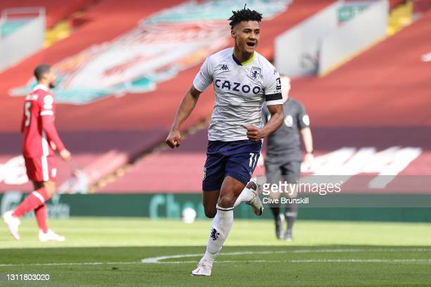 Ollie Watkins of Aston Villa celebrates after scoring their team's first goal during the Premier League match between Liverpool and Aston Villa at...