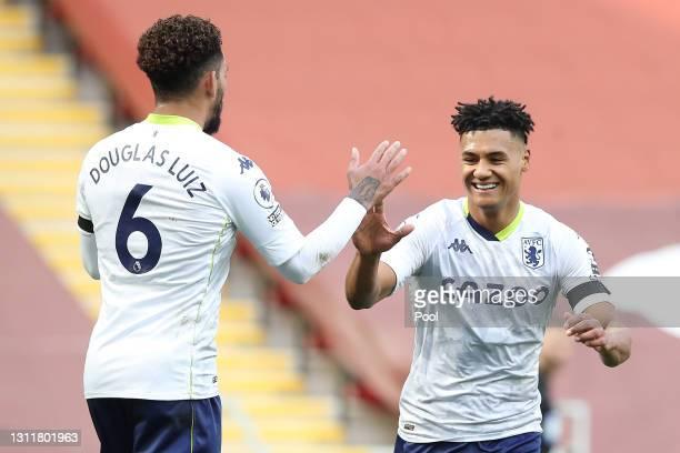 Ollie Watkins of Aston Villa celebrates with teammate Douglas Luiz after scoring their team's first goal during the Premier League match between...