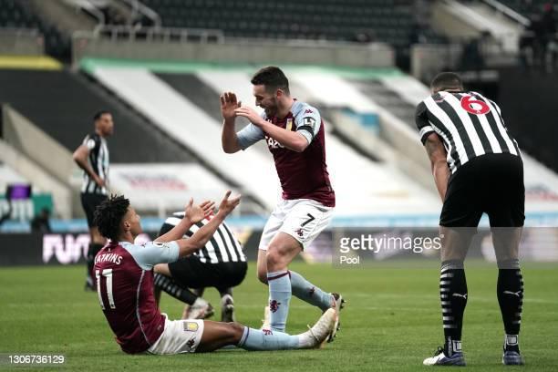 Ollie Watkins of Aston Villa celebrates with teammate JohnMcGinn of Aston Villa after scoring their team's first goal during the Premier League...