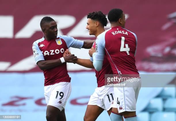 Ollie Watkins of Aston Villa celebrates with teammates Marvelous Nakamba and Ezri Konsa after scoring his team's first goal during the Premier League...