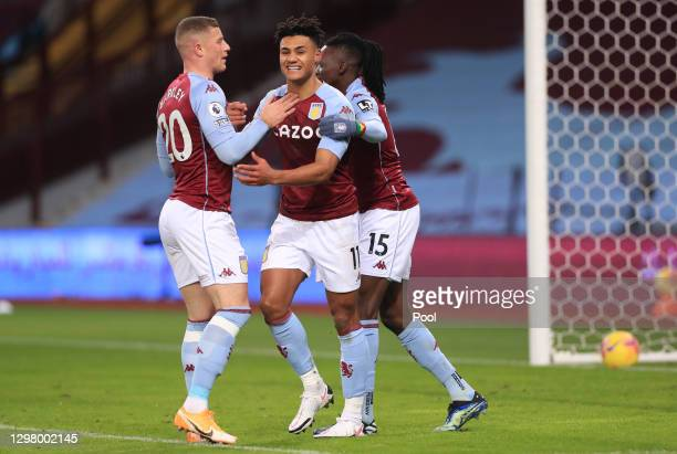 Ollie Watkins of Aston Villa celebrates with teammates Ross Barkley and Bertrand Traore after scoring their team's first goal during the Premier...