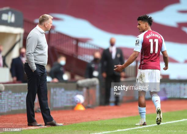 Ollie Watkins of Aston Villa interacts with Dean Smith, Manager of Aston Villa after being shown a Red Card during the Premier League match between...