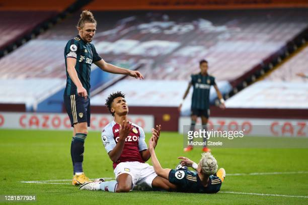 Ollie Watkins of Aston Villa reacts after a missed chance as Luke Ayling of Leeds United looks on during the Premier League match between Aston Villa...
