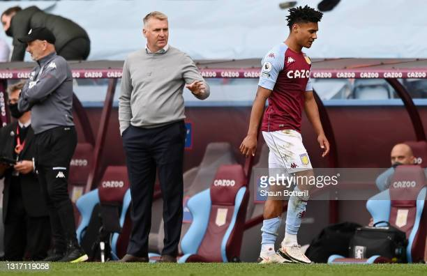 Ollie Watkins of Aston Villa reacts after being shown a red card as he walks past Dean Smith, Manager of Aston Villa during the Premier League match...