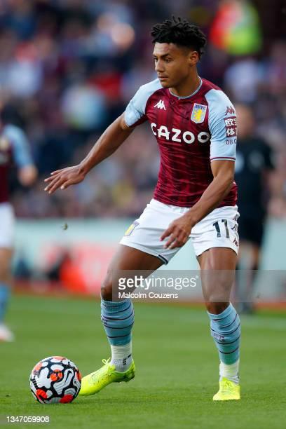Ollie Watkins of Aston Villa runs with the ball during the Premier League match between Aston Villa and Wolverhampton Wanderers at Villa Park on...