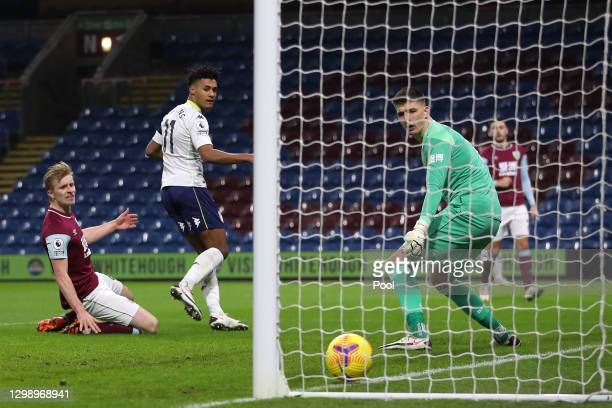 Ollie Watkins of Aston Villa scores their sides first goal under pressure from Ben Mee of Burnley during the Premier League match between Burnley and...