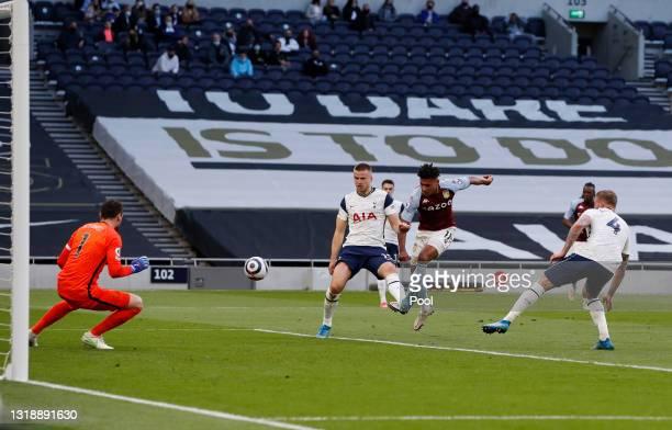 Ollie Watkins of Aston Villa scores their side's second goal past Hugo Lloris of Tottenham Hotspur whilst under pressure from Eric Dier of Tottenham...