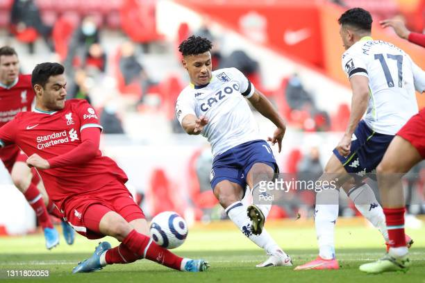Ollie Watkins of Aston Villa scores their team's first goal during the Premier League match between Liverpool and Aston Villa at Anfield on April 10,...