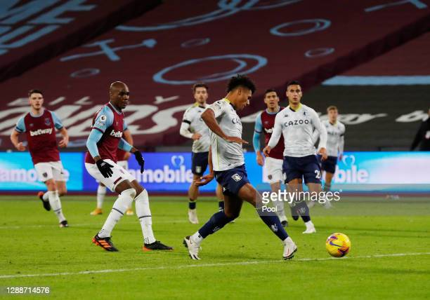 Ollie Watkins of Aston Villa scores their team's second goal which is later ruled offside by VAR during the Premier League match between West Ham...
