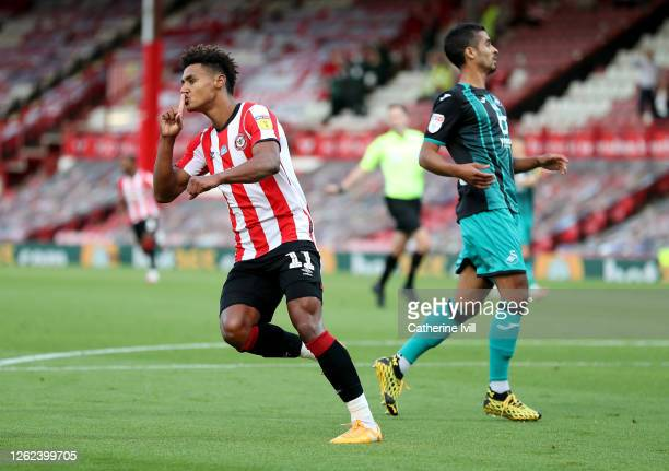 Ollie Watkins of Brentford celebrates after he scores the opening goal during the Sky Bet Championship Play Off Semi-final 2nd Leg match between...