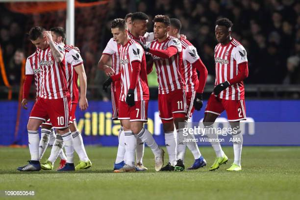 Ollie Watkins of Brentford celebrates after scoring a goal to make it 10 during the FA Cup Fourth Round match between Barnet and Brentford at The...