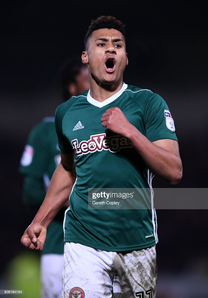 Ollie Watkins of Brentford celebrates after scoring his sides second goal during the Sky Bet Championship match between Burton Albion and Brentford at the Pirelli Stadium on March 6, 2018 in Burton-upon-Trent, England.