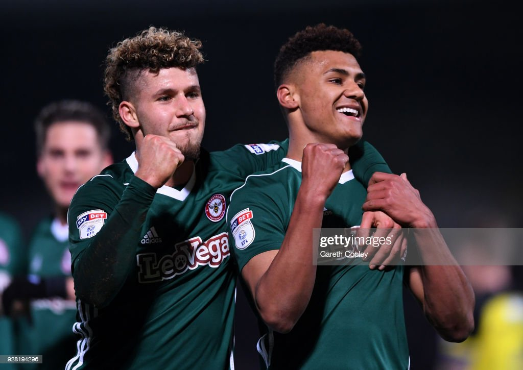 Ollie Watkins of Brentford celebrates after scoring his sides second goal with Emiliano Macrondes of Brentford during the Sky Bet Championship match between Burton Albion and Brentford at the Pirelli Stadium on March 6, 2018 in Burton-upon-Trent, England.
