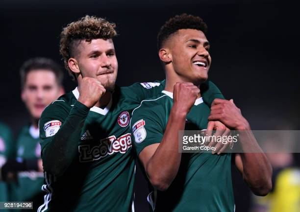 Ollie Watkins of Brentford celebrates after scoring his sides second goal with Emiliano Macrondes of Brentford during the Sky Bet Championship match...