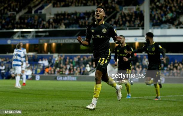 Ollie Watkins of Brentford celebrates after scoring his team's first goal during the Sky Bet Championship match between Queens Park Rangers and...