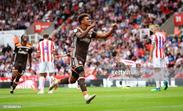 Ollie Watkins of Brentford celebrates as he scores the equaliser during the Sky Bet Championship match between Stoke City and Brentford at Bet365...