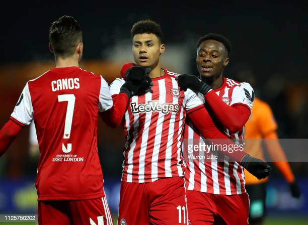 Ollie Watkins of Brentford celebrates with Sergi Canos and Moses Odubajo after scoring the opening goal during the FA Cup Fourth Round match between...
