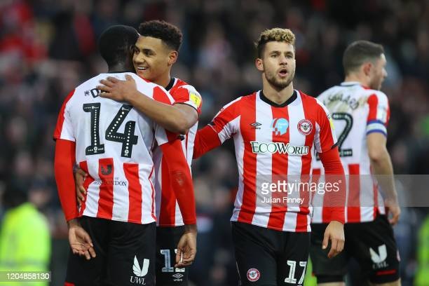 Ollie Watkins of Brentford celebrates with teammates after scoring his team's third goal during the Sky Bet Championship match between Brentford and...