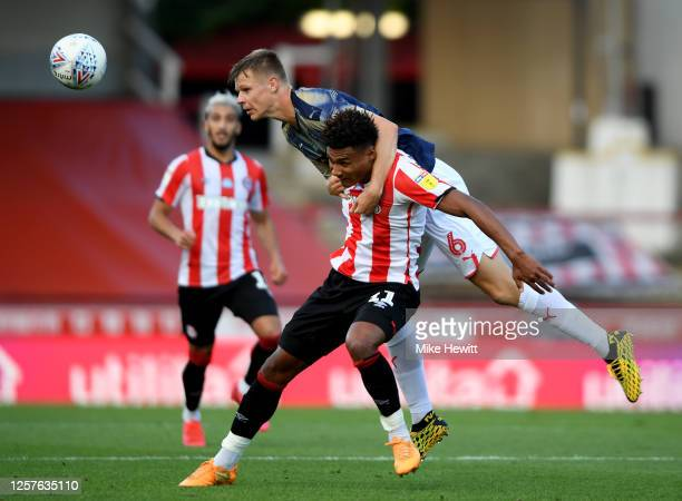 Ollie Watkins of Brentford challenges Mads Andersen of Barnsley during the Sky Bet Championship match between Brentford and Barnsley at Griffin Park...