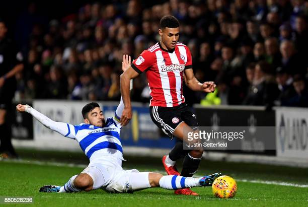 Ollie Watkins of Brentford gets away from Massimo Luongo of Queens Park Rangers during the Sky Bet Championship match between Queens Park Rangers and...