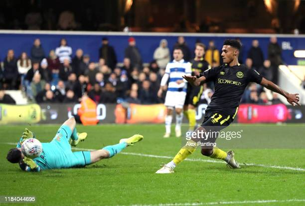 Ollie Watkins of Brentford scores his sides third goal during the Sky Bet Championship match between Queens Park Rangers and Brentford at The Kiyan...