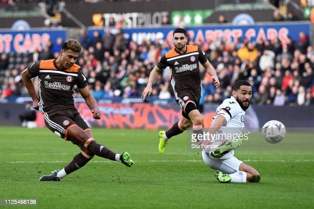 Ollie Watkins of Brentford scores his team's first goal during the FA Cup Fifth Round match between Swansea and Brentford at Liberty Stadium on...