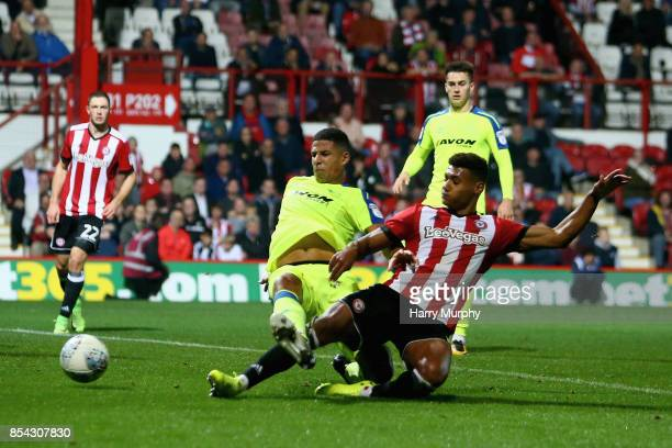 Ollie Watkins of Brentford scores his teams first goal during the Sky Bet Championship match between Brentford and Derby County at Griffin Park on...