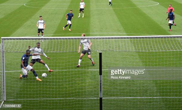 Ollie Watkins of Brentford scores the opening goal during the Sky Bet Championship match between Derby County and Brentford at Pride Park Stadium on...