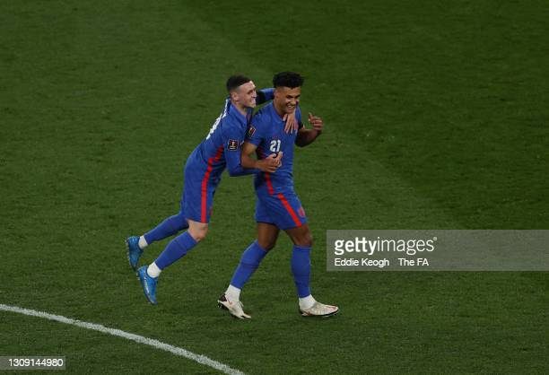 Ollie Watkins of England celebrates with teammate Phil Foden after scoring their team's fifth goal during the FIFA World Cup 2022 Qatar qualifying...
