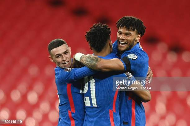 Ollie Watkins of England celebrates with teammates Phil Foden and Tyrone Mings after scoring his team's fifth goal during the FIFA World Cup 2022...