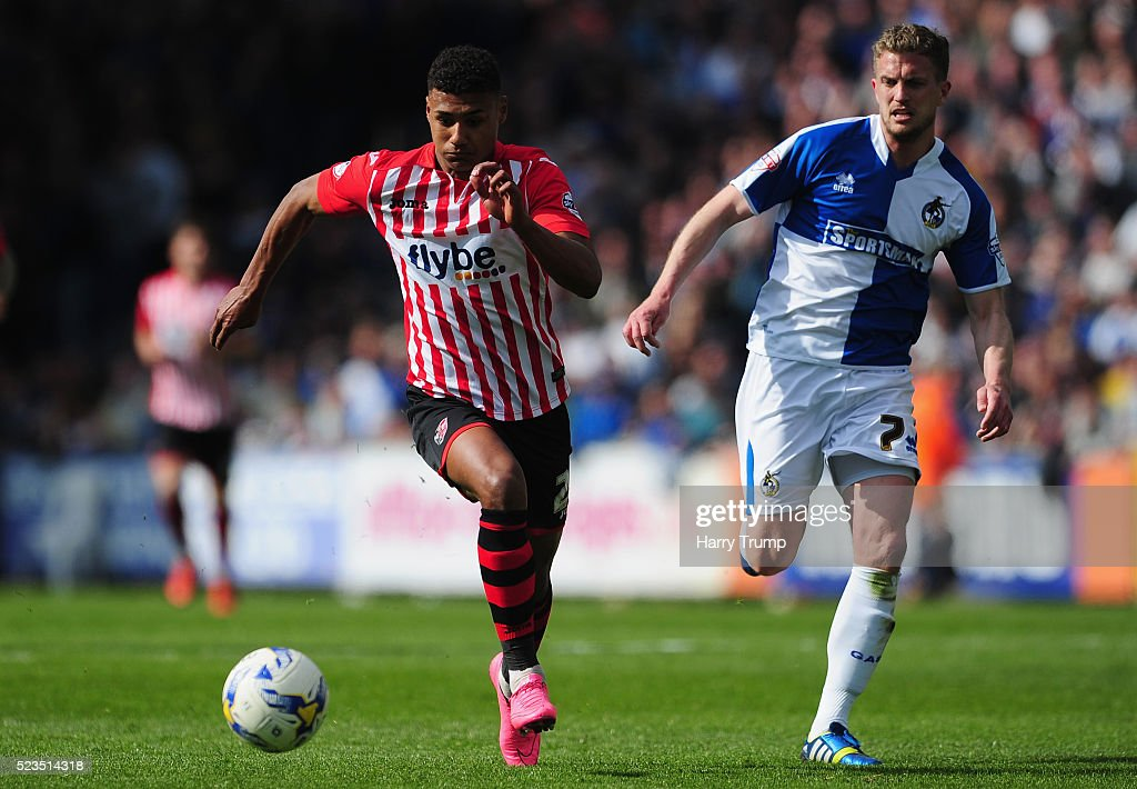 Ollie Watkins of Exeter City is tackled by Lee Mansell of Bristol Rovers during the Sky Bet League Two match between Bristol Rovers and Exeter City at the Memorial Stadium on April 23, 2016 in Bristol, England.