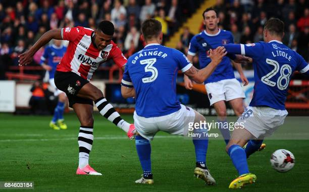 Ollie Watkins of Exeter City scores his sides first goal during the Sky Bet League Two Play off Semi Final Second Leg match between Exeter City and...