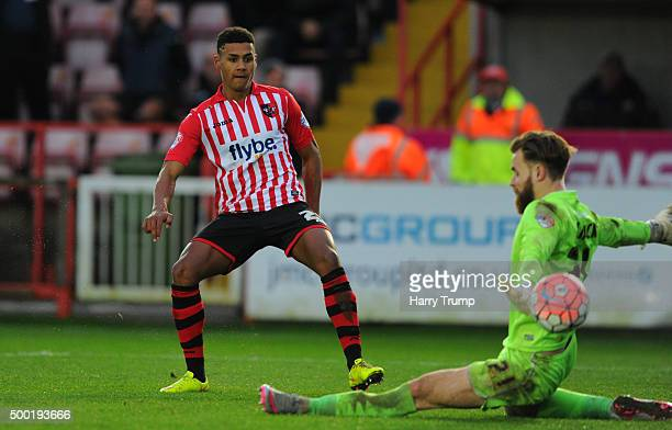 Ollie Watkins of Exeter City scores his sides second goal during the Emirates FA Cup Second Round match between Exeter City and Port Vale at St James...